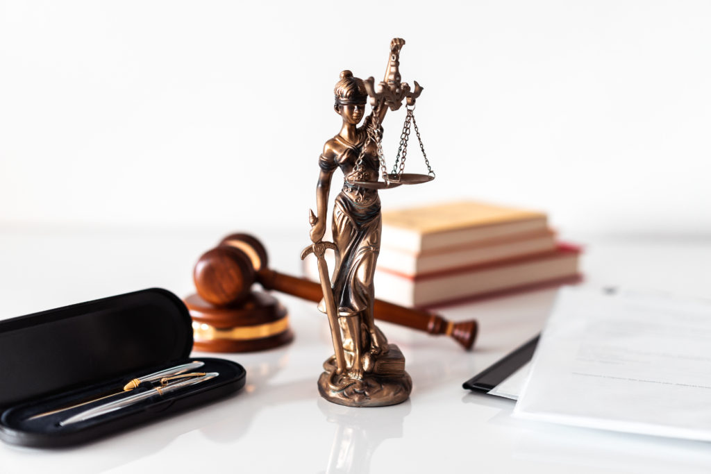 Photograph of the Blind Lady Justice on a Paralegal Law Firm desk.